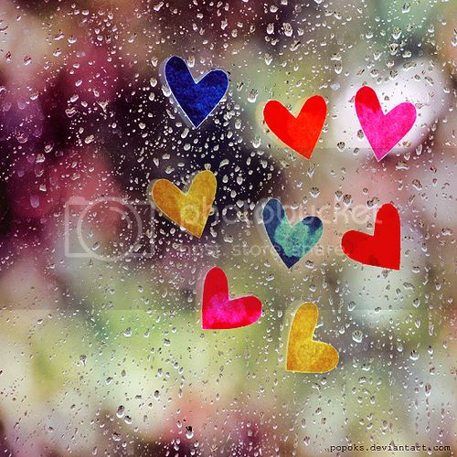 Colorful Hearts on Rainy Window